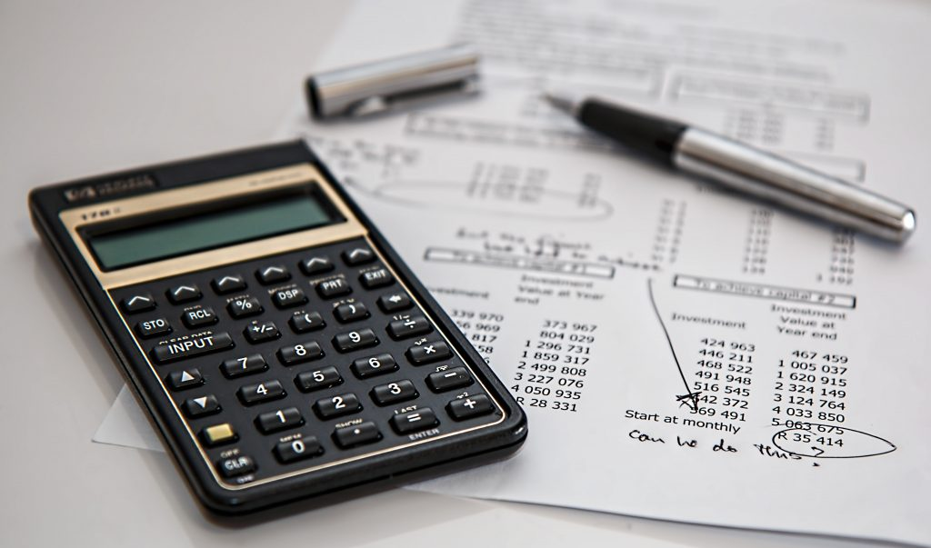 calculator ontop of financial document on table